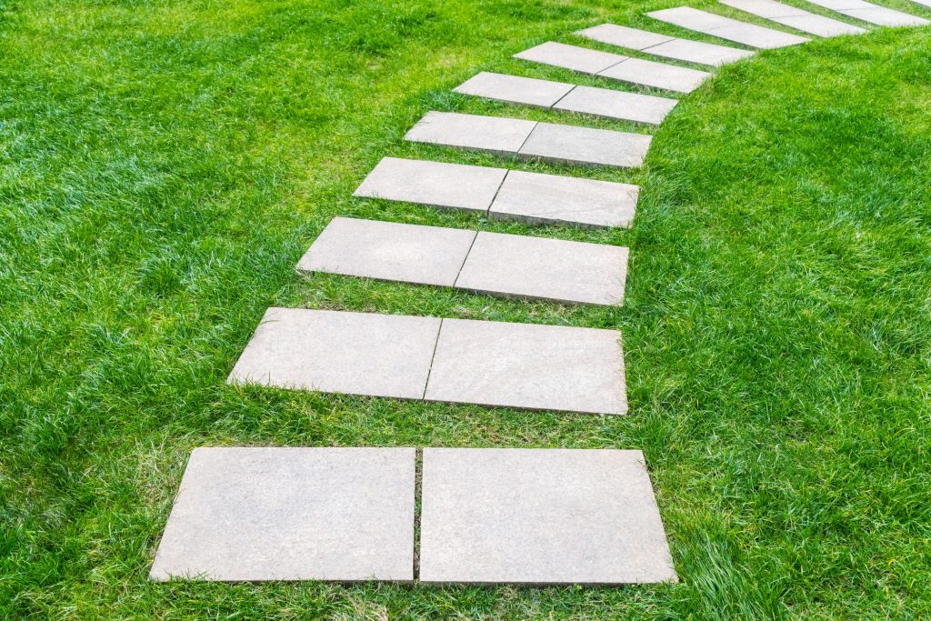 square stepping stones on front lawn